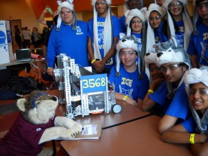 The ICE Wolves pose for a photo with their robot at the Liberty Science Center Qualifier.