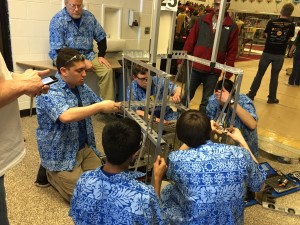 Pit crew members servicing the robot after a match.